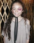 Yasmin Paige as Young Cosette in Les Misérables