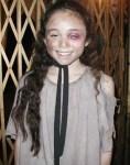 Yasmin Paige as Young Cosette in Les Misérables